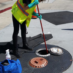 Worker cleaning a spill bucket